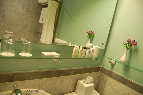 narrow glass shelf in bathroom
