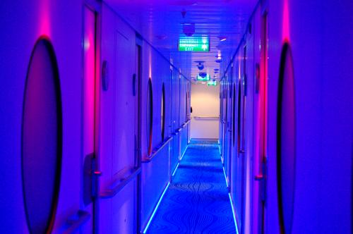 Norwegian epic 39 s studio staterooms for solo cruisers for Royal caribbean solo cabins