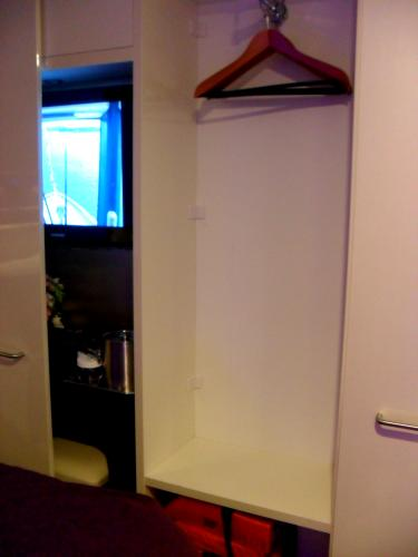 Studio Stateroom Closet and TV area