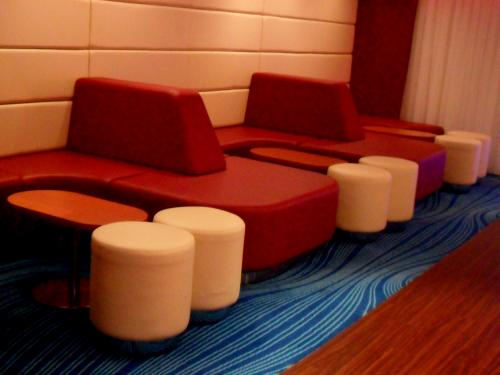 Studio lounge seating aboard NCL Epic